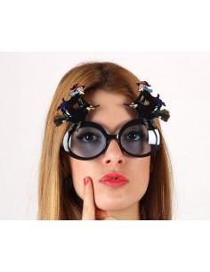Gafas brujas en escoba